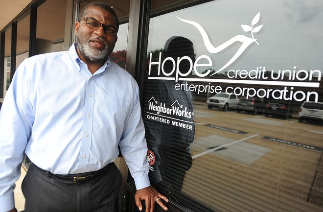 This 2013 photo shows Bill Bynum, CEO of Hope Credit Union in Jackson, Miss.