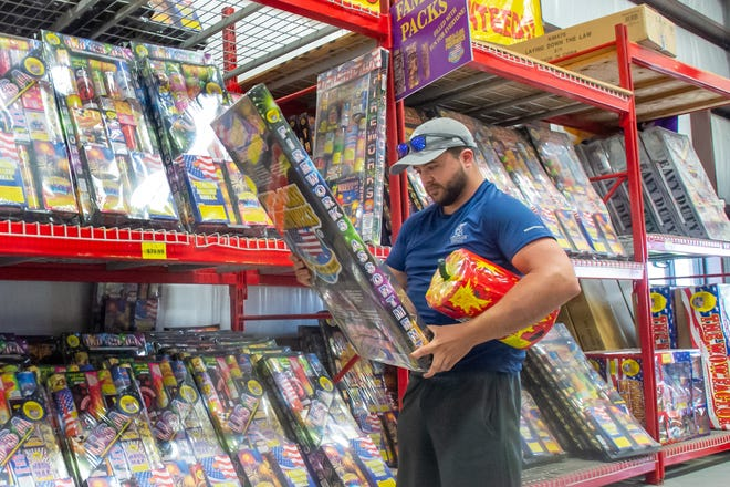 Jared Wunder shops for fireworks at Louisiana Fireworks in Broussard. Fireworks are legal in unincorporated areas of Lafayette Parish, but not in municipalities. Tuesday, June 30, 2020.