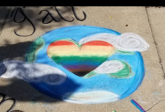 Chalk art celebrates Pride Month in front of the Historic Howell Theater