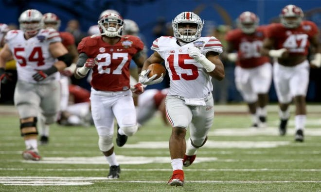 Ohio State's Ezekiel Elliott breaks away from Alabama defenders on an 85-yard touchdown jaunt in the 2015 Sugar Bowl.
