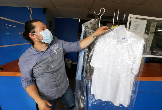 Prestige Dry Cleaners owner Oscar Marin wears a mask at work, as do all his employees. Customers also are asked to wear masks when entering the business at 4419 W. Fond Du Lac Ave. Under an ordinance being proposed by Milwaukee Ald. Marina Dimitrijevic, people in Milwaukee would be required to wear masks in public spaces, including at businesses.