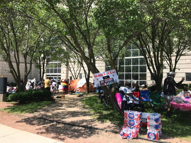Protesters camp outside the Milwaukee County Jail on Tuesday to demand that community activist Vaun Mayes be released after his arrest Monday. Mayes was released Tuesday afternoon.