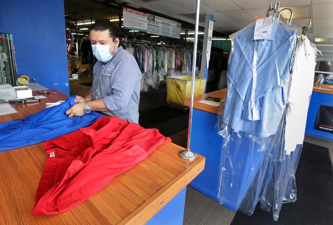 Prestige Dry Cleaners owner Oscar Marin works on filling an order, He closed the business for two months and a week starting sometime in March, both because of the threat of the virus and pretty much no demand for dry cleaning, and opened back up toward the end of May.