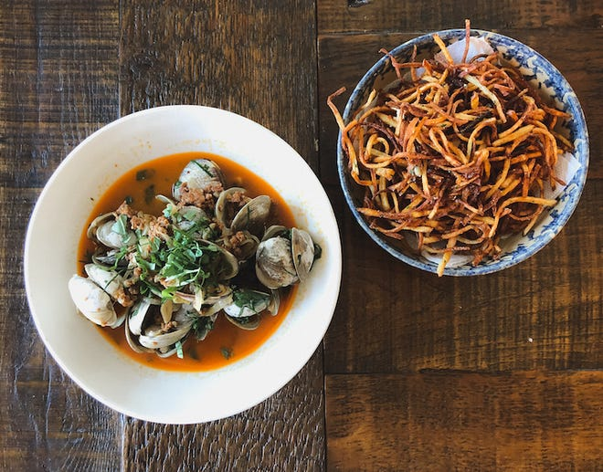 One of the shareable menu options at Mina in Crossroads Collective is Manila clams steamed in cider with chorizo, served with frites.