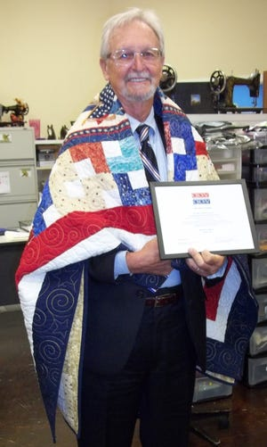 U.S. Army veteran Neauman Coleman was recently awarded a Quilt of Valor by Mountain Home Quilts of Valor at a safely conducted ceremony at Remember Me Quilt Shop in Mountain Home. Coleman served in Vietnam, and received 3 Purple Hearts, the Silver Star, two Bronze Medals (one with Valor) as well as numerous other military commendations.  Coleman authored an article for The Bulletin in March of this year relating to the Vietnam Veterans Day observed annually on March 29.