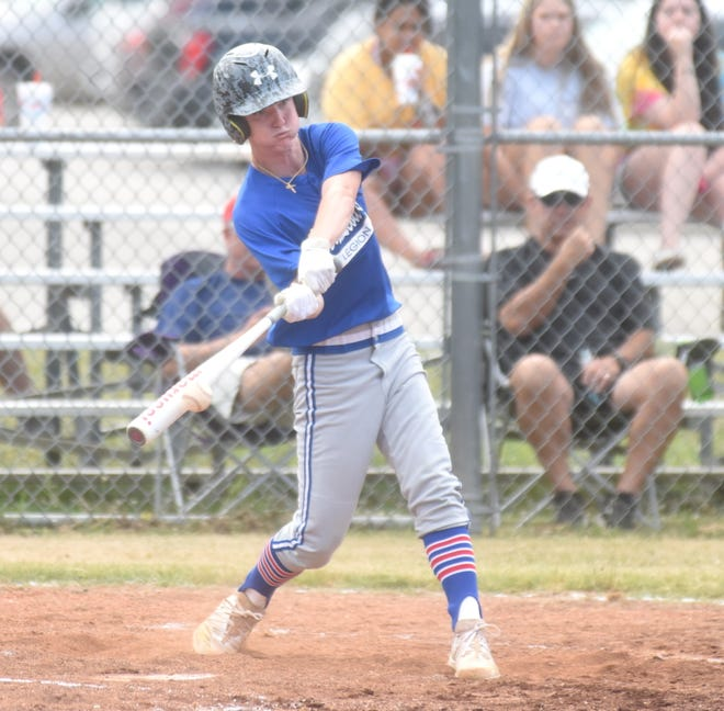 MacLeod's Lucas Spurlock connects for one of his three singles during Mountain Home's 14-0 victory over Flippin on Monday night.