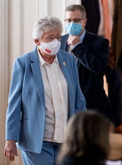 Governor Kay Ivey and State Health Officer Dr. Scott Harris arrive to ask citizens to continue wearing masks and use social distancing during a coronavirus update in the state capitol building in Montgomery, Ala., on Tuesday June 29, 2020.