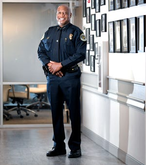 Metro Deputy Chief John Drake has a rising profile within the police department. Many see him as the most likely internal candidate to replace outgoing Chief Steve Anderson.  Drake stands next to photographs of past police chiefs in a hallway in police headquarters in Nashville on Tuesday, June 30, 2020.