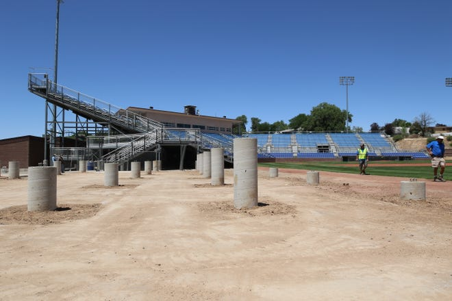 Seating renovations next to the first-base line continue on Tuesday, June 30, 2020, at Ricketts Park in Farmington.