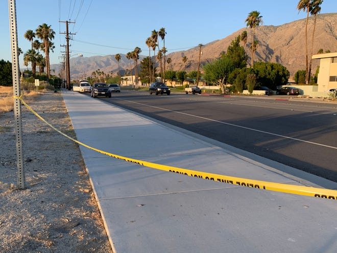 Security tape is visible at Indian Canyon Drive and Racquet Club Road in Palm Springs Tuesday, June 30, 2020. Palm Springs police were investigating a shooting that left a man in critical condition.