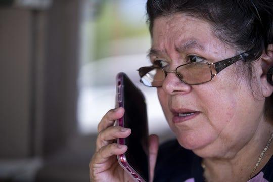 Catalina Soto, 60, speaks to her daughter on June 30, 2020, in Chandler.