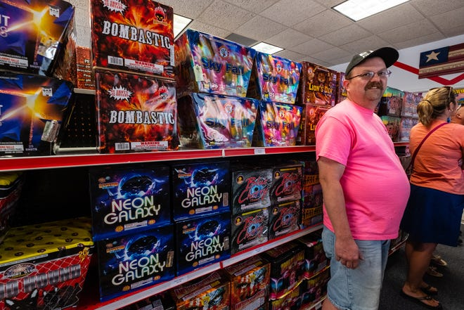 Roger Vargo, who owns R & R Fireworks in Port Huron Township, walks past different fireworks stocked on the shelves Tuesday, June 30, 2020. Despite a turbulent year, Vargo reports that fireworks at his store are selling well.