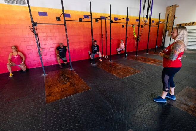Katie Kane, co-owner of Obscurus CrossFit, right, leads a crossfit class Tuesday, June 30, 2020, in the Port Huron gym. After hosting classes online through the coronavirus pandemic, the gym has reopened classes for members.