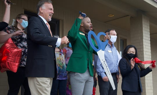 Guests at the new office of Texas Home Health in San Angelo cheer at a ribbon-cutting ceremony Tuesday, June 30, 2020.