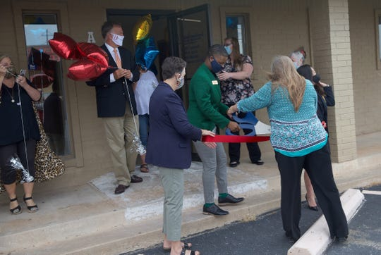 Guests at the new office of Texas Home Health in San Angelo prepare for a ribbon-cutting ceremony Tuesday, June 30, 2020.