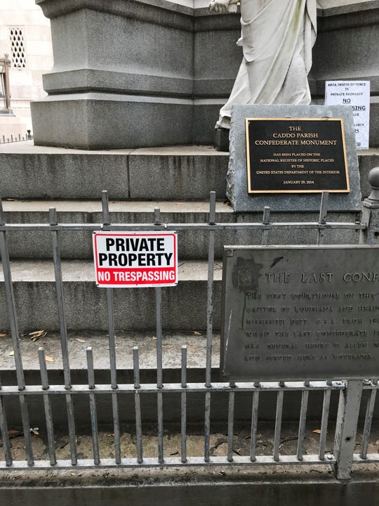 Signs on display outside of the Confederate Monument in Shreveport.