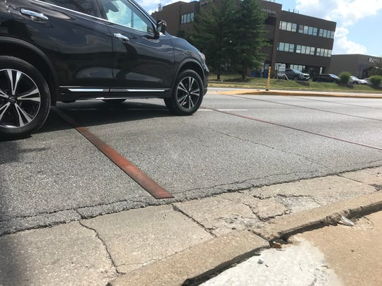 Answer Man: Why are there orange strips placed across Battlefield Road?