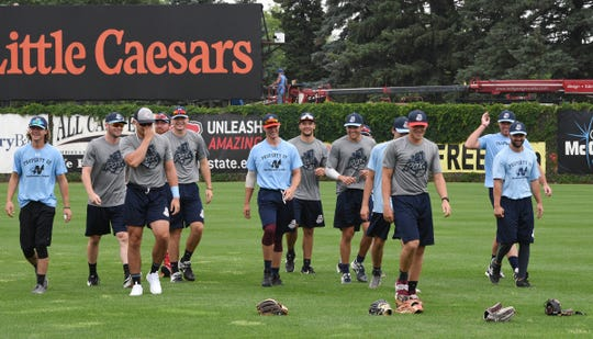 Rox players smile before beginning practice Tuesday, June 30, 2020, at Joe Faber field.