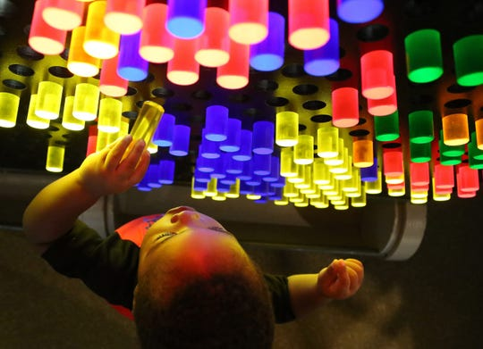 Zion Bolden plays at the Light Waves Ahead exhibit at The Children's Museum of the Upstate.