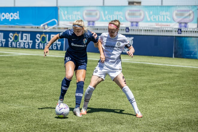 Buena High graduate Hailie Mace, left, of the North Carolina Courage is defended by the Portland Thorns' Becky Sauerbrunn during the NWSL Challenge Cup opener last Saturday at Zions Bank Stadium in Herriman, Utah.