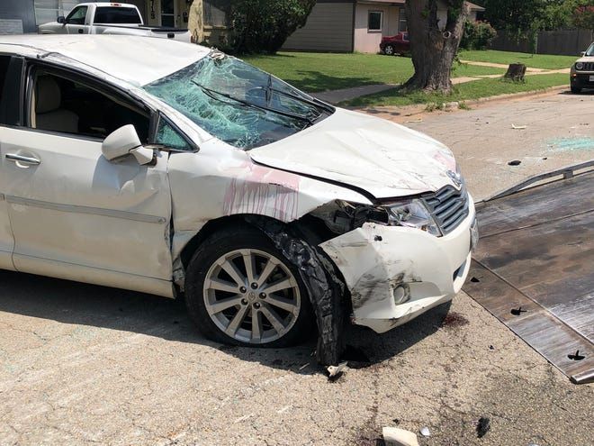 A Toyota is seen after an accident Tuesday that left the vehicle turned upside down in the middle of Bonny Drive.