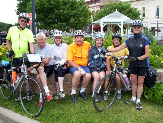 My 20-plus years of logging 1500-2000 miles annually on a bicycling across a multitude of states is a treasured memory. Here the Wright Riders pause for a photo about ten years ago. Columnist John Oncken is pictures in the center wearing a bright yellow shirt.