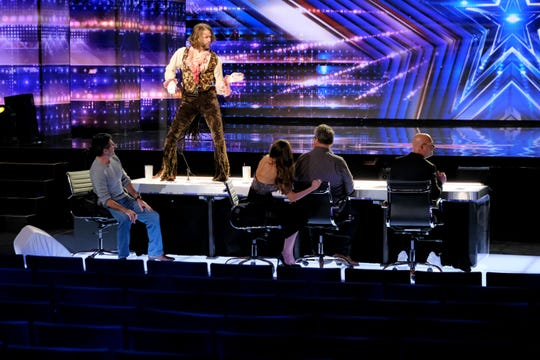 Rob 'The Marquise' Messel, standing, auditions for 'America's Got Talent' judges Simon Cowell, left, Sofia Vergara, Eric Stonestreet and Howie Mandel in the the nearly empty Pasadena Civic Auditorium.
