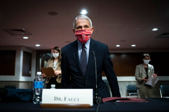 Dr. Anthony Fauci , director of the National Institute of Allergy and Infectious Diseases, arrives for a Senate committee hearing on Capitol Hill Tuesday.