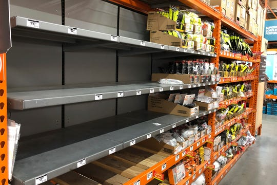 Shelves that held masks and respirators are bare at a Home Depot Store in Seattle on March 3. Hospitals are concerned about a shortage of face masks, which people have been snatching up despite pleas from health officials.