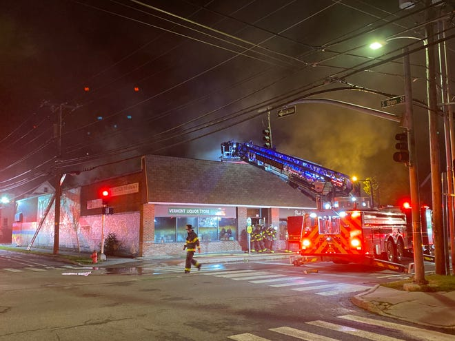 City firefighters respond to a blaze at Pearl Street Beverage in Burlington about 2:45 a.m. on Wednesday, July 1, 2020.