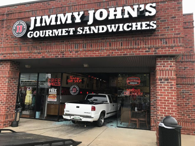 A pick up truck crashed through the front doors of Jimmy John's on Madison Street on Wednesday.