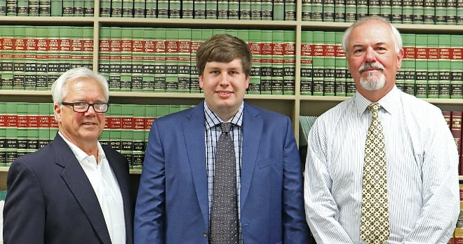 Paul R. Scherbel and Donald A. Wietmarschen with new lawyer Seth Finton, center, of Coshocton. The law firms of Gottlieb, Johnston, Beam and Dal Ponte of Zanesville and Leech, Scherbel & Peddicord of Coshocton officially merged as of July 1 and are opening a new office in McConnelsville. Finton has also recently joined the combined firm.