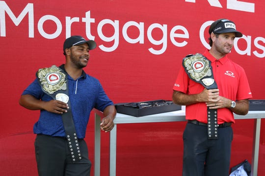 Harold Varner III, left, and Bubba Watson pose with their champions belt after being the winners of the Rocket Mortgage Classic's 'Changing the Course' charity golf event at Detroit Golf Club, July 1, 2020.
