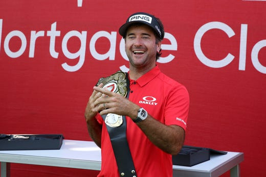 Bubba Watson poses with the champions belt after being a winner of the Rocket Mortgage Classic's 'Changing the Course' charity golf event, 12-time PGA TOUR winner and two-time Masters champion Bubba Watson and Harold Varner III versus former World No. 1 Jason Day and Wesley Bryan nine-hole exhibition at Detroit Golf Club, July, 1, 2020.