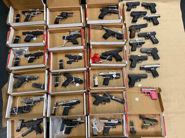 A photo of the handguns retrieved by Directed Patrol Units in Pontiac.