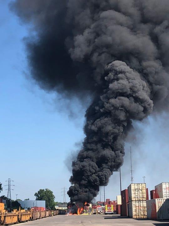 Smoke is seen billowing from a crane that caught fire at the CN Detroit Moterm rail yard in Ferndale on Wednesday, July 1, 2020.