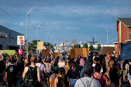 Protesters march back toward the Detroit Police Department's 4th Precinct in Detroit on June 30, 2020.