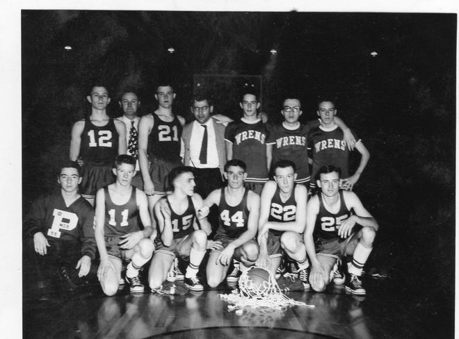 Sectional picture – First row, (from left) student manager Larry Hartley, Bill Stone (11), Van Gehl (15), Paul Stone (44), Bruce Johnson (22), Lawrence Hulfachor (25). Second row – Fred Sanders (12), Principal Sanford Sanders, Don Sloan (21), Coach Herman Sollman, Donald Hudson, John Beatty, Charles Albright.