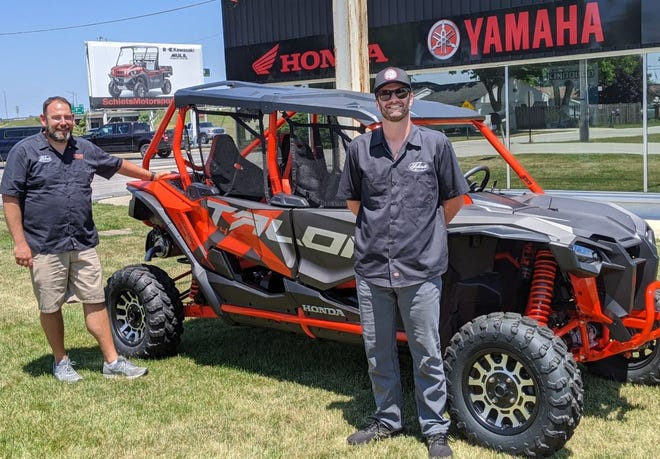 Dane Fox, left and Nate Pfeiffer, right, took over Schiets Motorsports in December and have seen double the sales since COVID-19 pandemic.
