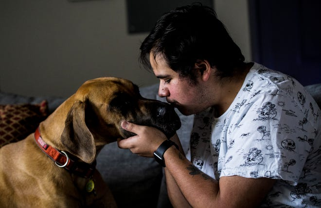 Fort Myers resident Aldo Martinez,26, shows affection to his dog Kara in his apartment on Wednesday, July 1, 2020. Martinez is a DACA recipient. He came to the U.S. when he was 12. He went to school in Miami and is now a paramedic in Southwest Florida. While Martinez said he was relieved the Supreme Court of the United States upheld DACA, he still feels uncertain without a long-term legislative solution.