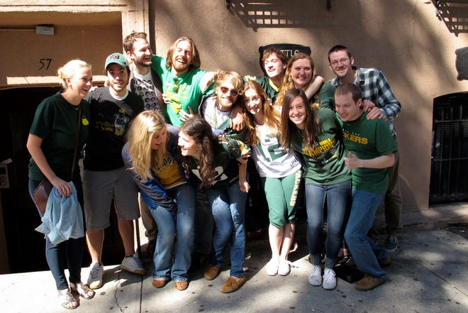 A group of Notre Dame Academy graduates show off their Packers colors outside the Kettle of Fish bar in Greenwich Village a few years ago. Back row, from left: Nick Machesney, Ben Lynch, Jake Sedlar, Shawn Connelley, Jake Schmidt, Annie Kiefer and John Lynch. Front row, from left: Andrea Roscoe, Stephanie Harril Kyle, Elise Melendez, Erin Hermsen and Todd Schmidt.