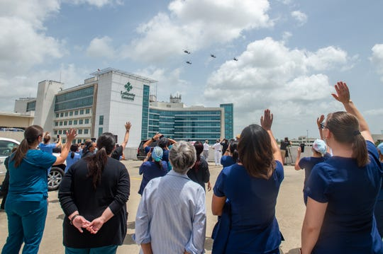 Four UH-60 Black Hawks from the Louisiana Army National Guard's State Aviation Command fly over Lafayette General Medical Center hospital Wednesday to honor first responders and health care professionals who have been working the frontlines of the COVID-19 response. Wednesday, July 1, 2020.