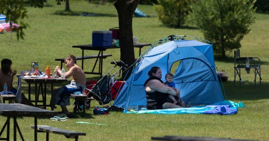 People stay cool near the beach at Hartman Creek State Park in Waupaca. About 200,000 people each year visit the 1,500-acre park, which offers swimming and fishing in Hartman Lake, 10 miles of hiking trails and eight miles of biking trails.