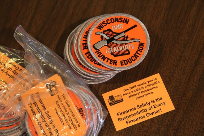 Patches and safety cards are given to graduates of Wisconsin hunter education classes.