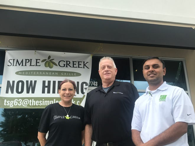 From left, Becca Bohannon, Gary McGahan and Milan Patel prepare to open Simple Greek in east Montgomery.