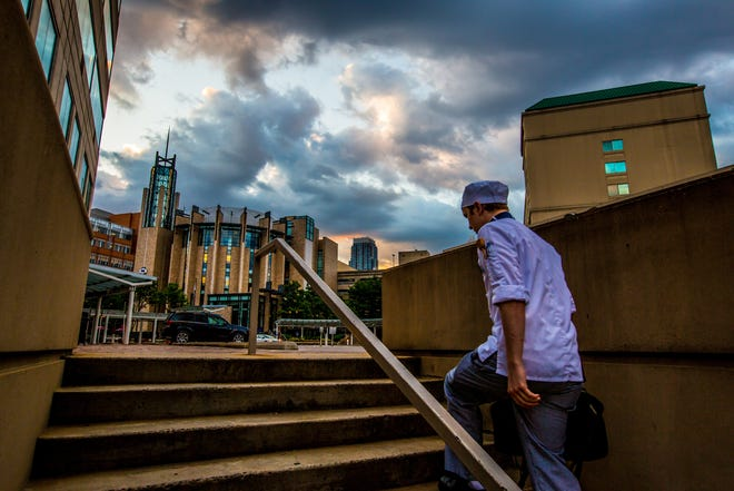 A culinary student heads to classes at the Charlotte campus of Johnson & Wales University.