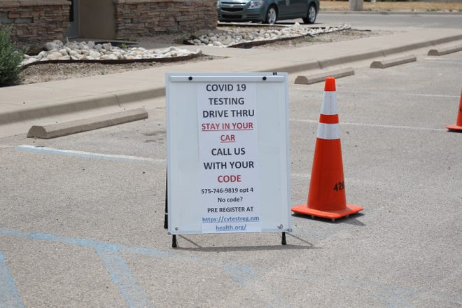 A sign at the Artesia Public Health Office on July 1, 2020 reminds people to pre-register to get tested for COVID-19.