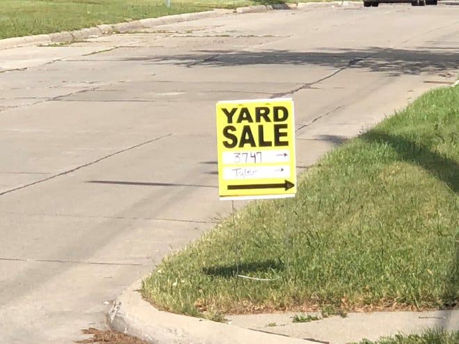 A sign advertises a yard sale in Oakland County in June 2020. Such sales continue despite the COVID-19 pandemic.