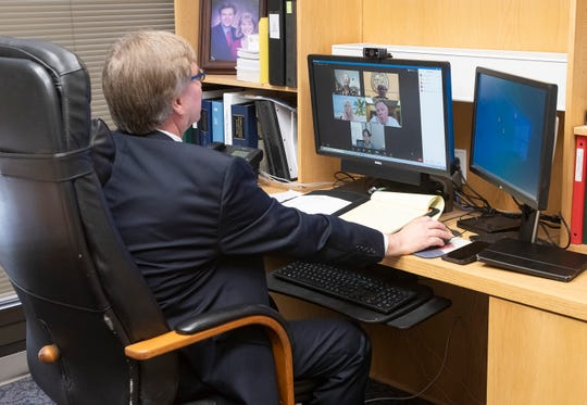 Chief Circuit Judge John Miller uses online technology to handle a family law hearing in his chambers via zoom on Wednesday, July 1, 2020.