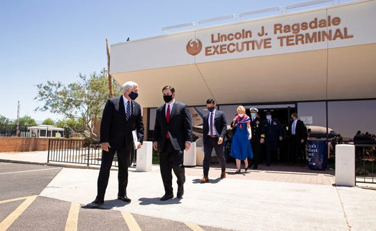 Vice President Mike Pence talks to Gov. Doug Ducey after their meeting at Sky Harbor International Airport in Phoenix on July 1, 2020. Pence is leading the White House Coronavirus Task Force and is visiting Arizona, one of the new coronavirus hotspots in United States.